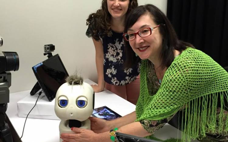 Adorable Blue-Eyed Robot Teaches Infants To Communicate